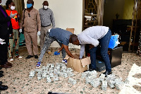 Detectives search an office in Munyonyo where eight foreigners were arrested