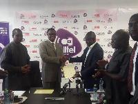 Dr Prince Kofi Kludjeson and Emmanuel Dabi during the signing of MOU