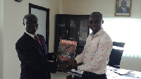 Henry Teinor, CEO of EMG presenting magazine Prof. George Gyan-Baffour, Planning Minister