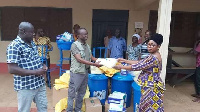 The MP hands over items for donation