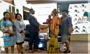 Dr. Zakariah (right) receiving the items from UNFPA Country Representative, Mr Ojuolape
