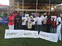 The winners displaying their trophies and dummy certificates with captain and sponsors