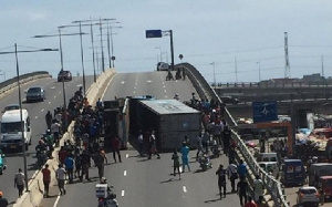 The truck lay in the middle of the road whilst Security personnel tried to curl the situation
