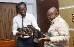 Kofi Kingston presents the WWE belt to Akufo-Addo