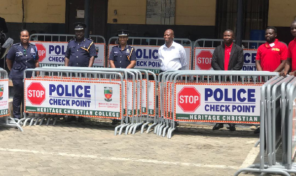 Heritage Christian College hands over 50 reflective barricades to the Police