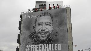 A giant portrait of Algerian journalist Khaled Drareni made by street artist Christian Guemy