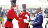 President Akufo-Addo presenting the overall best cadet to Master Daniel Opoku Buadu