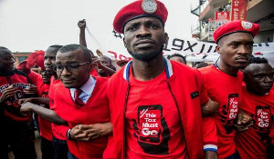 Uganda's opposition presidential candidate, Bobi Wine flanked by others