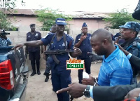 Charles Nana Frimpong being escorted by the police after the court hearing