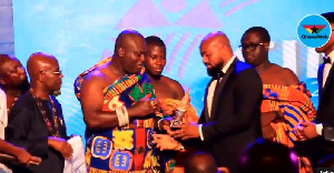 Dr. Daniel Mckorley, CEO of McDan Group receiving his award from Odeneho Kwafo Akoto III
