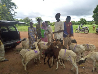 Muhazu Jibril presenting the animals to the beneficiaries