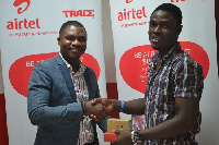 Michael Acheampong, Media Manager, Airtel Ghana presenting the Prize Items to Bright Phillips