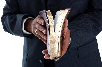 A man holding a Bible