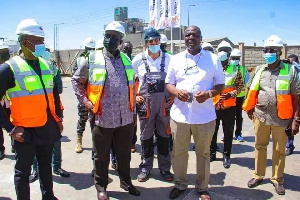 Alan Kyerematen with Ibrahim Mahama when he visited Dzata Cement Limited