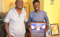 Samuel Addai Agyekum (R) received the award