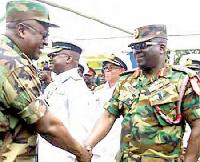 John Mahama greeting Major Gen. Sampson Adeti at Burma Camp