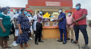Adam Abdul Majeed donating items to Manhyia Government Hospital