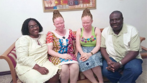 The 'Golden Twins' flanked by their parents