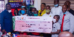 Joseph Awinongya Jr presented $500 to the Motherly Love Foundation