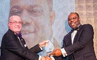 Ambassador Robert Porter Jackson presenting the award to Matthew Opoku Prempeh