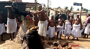 Aflao traditional priests offering sacrifice to deities of the land