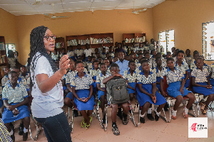 Benedicta Ama Batcho, Founder and CEO of AmaCares with some of the students