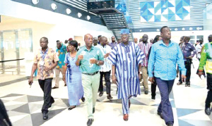 Minister of Aviation, Mr Kofi Adda being conducted on a tour by the Managing Director of the GACL