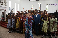 First Lady Mrs Rebecca Akufo-Addo taking a selfie with school girls from La and Teshie