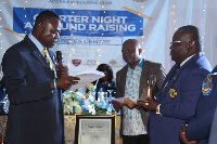 Lions District Governor, Dr. Kwabena Mensa-Bonsu presenting the Charter to Edward Adzimah