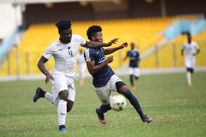 Accra Lions midfielder Oliver Amedor in a tussle with Black Meteors defender