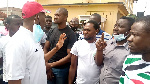 Asawase MP Muntaka Mubarak with some of the NDC supporters at the police station