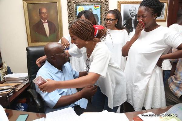 Teary Nana Dokua Akufo-Addo looks on as her sister hugs their father