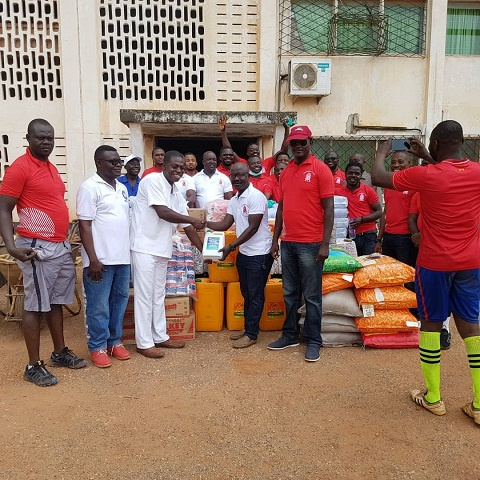 Members of the Sons of Bacchus group, donating some items to management of the Pantang facility