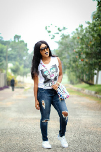 AkosuaVee in 'destroyed' demin jeans