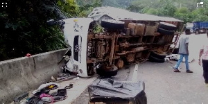 The truck somersaulted and crashed at the side of the road