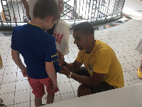 Kwesi Appiah signing a jersey for a fan