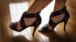 The writer says wearing high heels for long usually causes disabilities in women