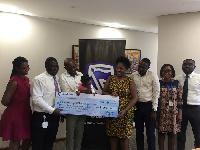 Staff of Stanbic Bank donating the cheque to Elaine Esther Akosua Owusu