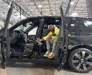 Davido poses in his new car