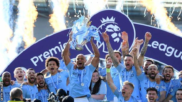 Manchester City lift the Premier League trophy following their 4-1 victory at Brighton