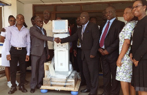 Management of Tema Lube Oil presenting the ventilator to Dr Kwabena Opoku-Adusei
