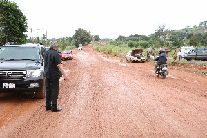 Former President Jerry Rawlings inspecting sections of the Sokode-Ho road on Thursday