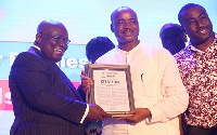 Chamber Business Man of the Year Issa Ouedraogo(middle) receiving his citation from Prez Akufo-Addo