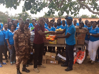 Members of St Peter and Paul Commandery #747 donates to Awutu Prison camp