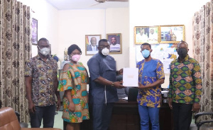 Joshua Ahalivor (second from right) presenting the Humidifier to the MCE