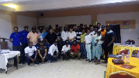 Somoco Ghana Limited personnel in a group picture with retailers