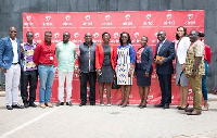 Minister with Lucy Quist (middle) with the Deputy Ministers and leadership team of Airtel Ghana