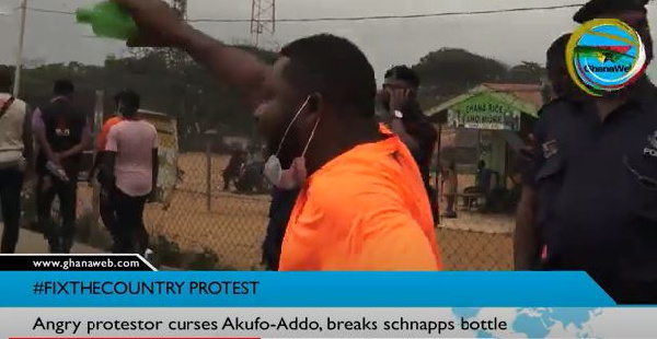 #FixTheCountry Protest: Angry protestor curses Akufo-Addo, breaks schnapps bottle