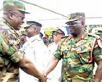 John Mahama in a handshake with Major General Sampson Adeti