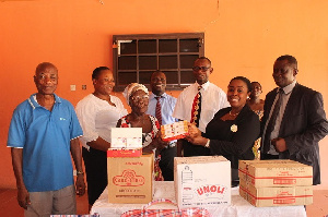 Mrs. Obuobi [second right] presents the items to the inmates of the Weija Leprosarium